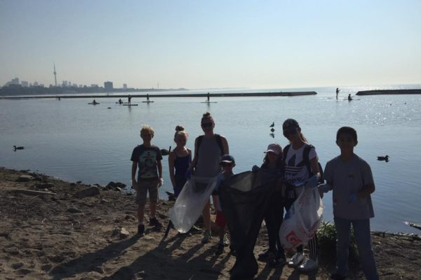 Community members celebrate Coastal Cleanup Day 2017 by cleaning the Lake Ontario shoreline.